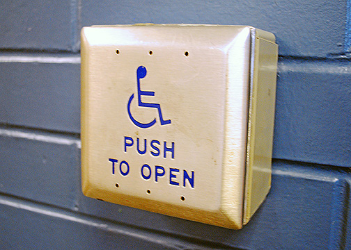 An access door button that is used by wheel chair bound individuals to help physically exit T.H. Bell.